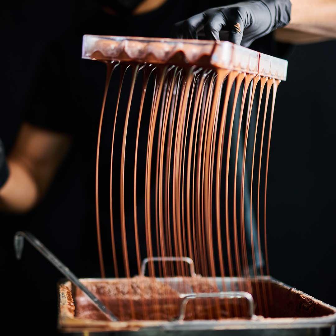 Making of chocolate bon bon in Chocolate Concierge's kitchen
